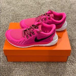 Brand new pink girls Nike Free, size 3.5